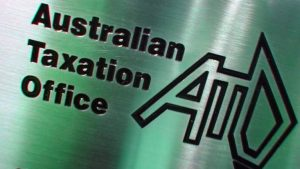 brushed metal sign displaying Australian Tax Office and th ATO logo